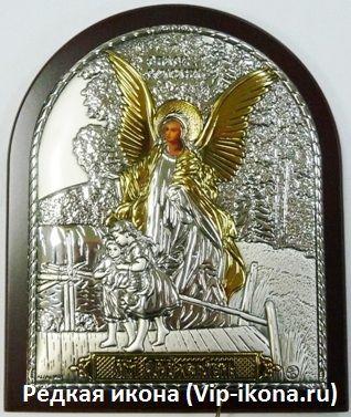 Серебряная с золочением икона Ангела Хранителя ребенка (9*11см., Россия) в дорожном футляре